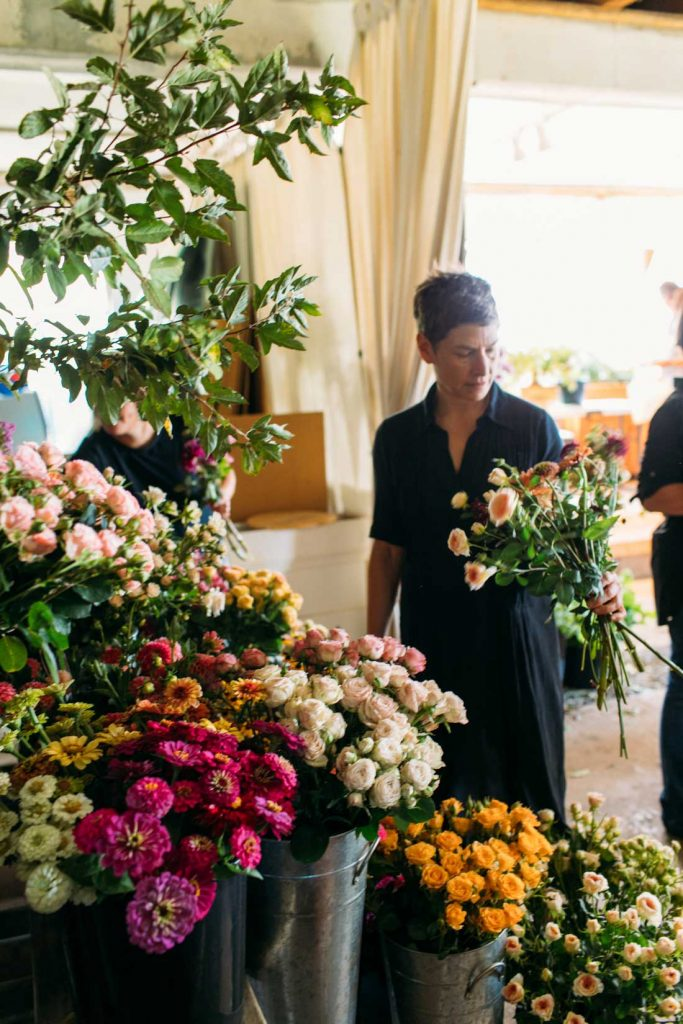 designer Sidra Forman at LynnVale flower farm, photo by Kate Headley